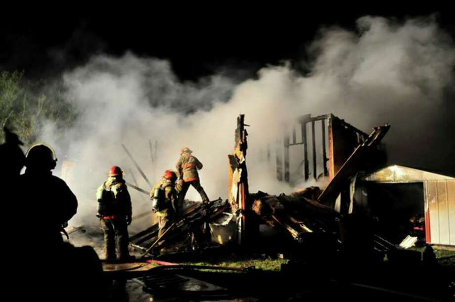 A man and a woman in their 60s were killed early Friday morning in a house fire in Jourdanton. Fire officials said two oilfield workers were on their way to work when they spotted flames shooting out of a home in the 400 block of Main Street at 3:30 a.m. The men called 911 and banged on the front door while they waited for firefighters to arrive. When firefighters arrived, they found the house fully engulfed in flames. They entered the home and found the bodies. The remains of the victims were taken to the Bexar County Medical Examiner's Office. The Atascosa County Fire Marshal's Office is investigating.  Xavier J. Garcia/ Fro the San Antonio Express-News