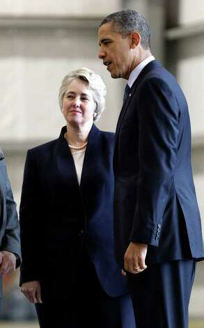 President Barack Obama, right, meets with Houston Mayor Annise Parker during his arrival at Ellington Airport, Friday, March, 9, 2012, in Houston. Photo: AP