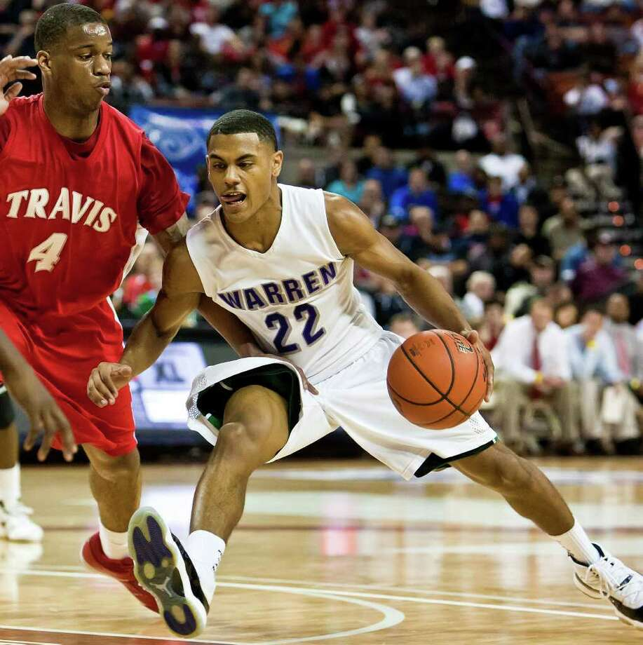 TRAVIS 85, WARREN 71- Warren's Jordan Corona (right) tries to drive past Fort Bend Travis's Christian Crockett during the third quarter of their 5A state semifinal game at the Frank Erwin Center in Austin on March 9, 2012.  MARVIN PFEIFFER/ mpfeiffer@express-news.net Photo: MARVIN PFEIFFER, Marvin Pfeiffer/ Express-News / Express-News 2012
