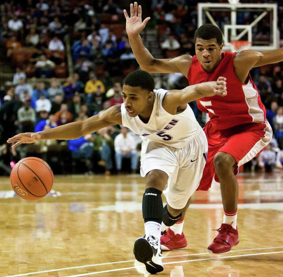 Warren's Marcus Keene tries to maintain possession of the ball as Fort Bend Travis's Andrew Harrison applies pressure during the second quarter of their 5A state semifinal game at the Frank Erwin Center in Austin on March 9, 2012.  MARVIN PFEIFFER/ mpfeiffer@express-news.net Photo: MARVIN PFEIFFER, Marvin Pfeiffer/ Express-News / Express-News 2012