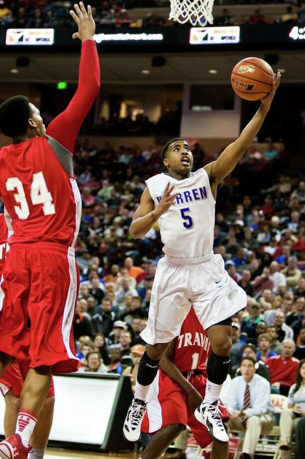 Warren's Marcus Keene puts up a layup as Fort Bend Travis's DeQuarious Davis tries to defend during the first quarter of their 5A state semifinal game at the Frank Erwin Center in Austin on March 9, 2012.  MARVIN PFEIFFER/ mpfeiffer@express-news.net Photo: MARVIN PFEIFFER, Marvin Pfeiffer/ Express-News / Express-News 2012