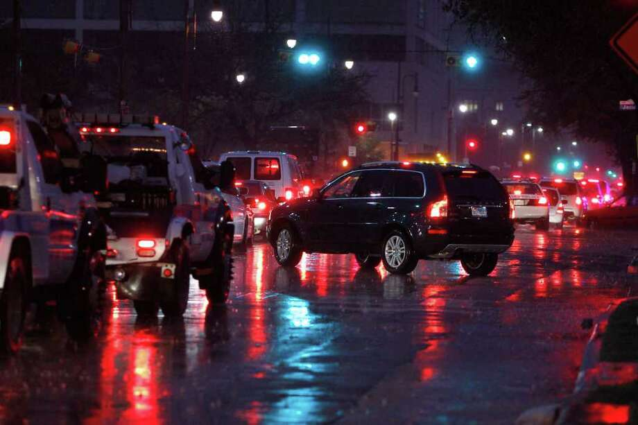 Traffic was at a near stand still outside of Minute Maid Park as police halted traffic for the arrival of President Barack Obama, Friday, March 9, 2012, in Houston, enroute to a campaign event at Minute Maid Park. Photo: Karen Warren, Houston Chronicle / © 2012  Houston Chronicle