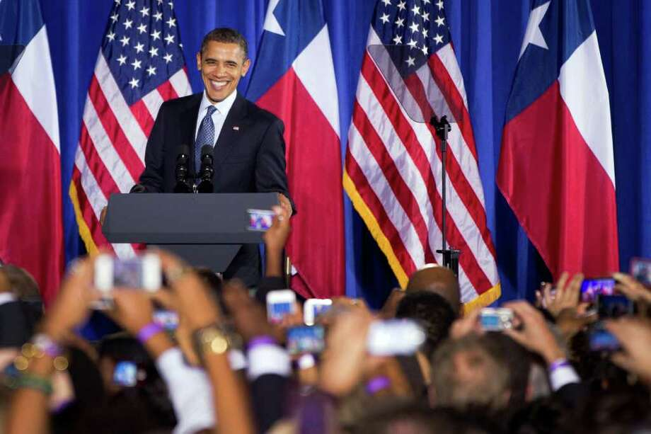 President Barack Obama smiles as addresses supporters at a fundraising event at Minute Maid Park's Union Station on Friday, March 9, 2012, in Houston. Photo: Smiley N. Pool, Houston Chronicle / © 2012  Houston Chronicle