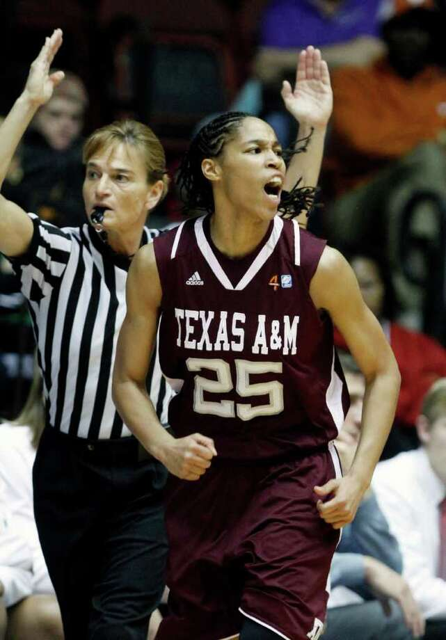 Texas A&M guard Skylar Collins (25) celebrates a 3-point basket against Oklahoma  during the first half of an NCAA college basketball semifinal game at the women's Big 12 Conference tournament, Friday, March 9, 2012 in Kansas City, Mo. (AP Photo/Jeff Tuttle) Photo: Jeff Tuttle, Associated Press / FR170439 AP