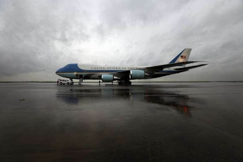 Air Force One sits at Ellington on the stormy Friday. (TODD SPOTH / For The Chronicle)