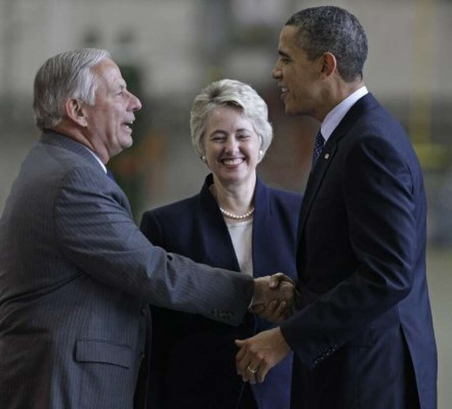 Congressman Gene Green and Mayor Annise Parker welcome Obama at Ellington Field. (Melissa Phillip / Houston Chronicle)
