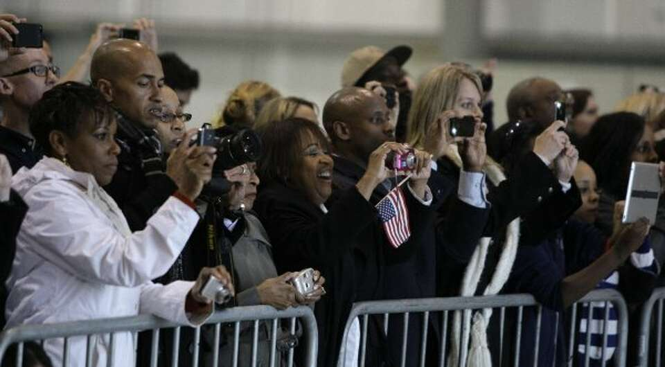 Supporters watch as Air Force One arrives at Ellington. (Melissa Phillip / Houston Chronicle)