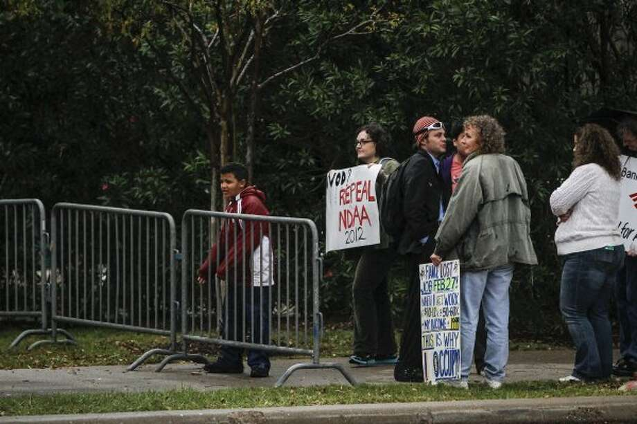 Not everyone was happy to see Obama. Protesters gather near Minute Maid. (Karen Warren / Houston Chronicle)