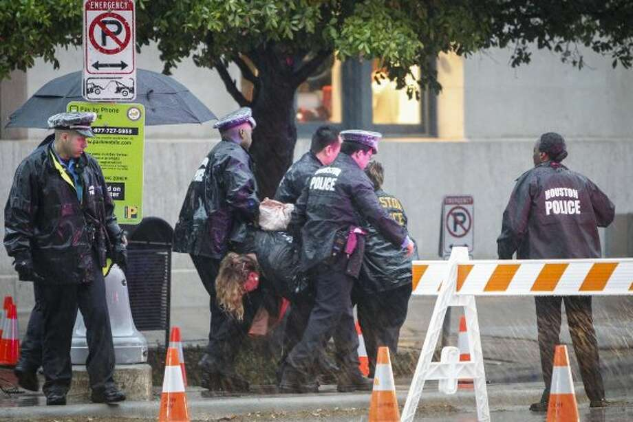 Houston police detain an unidentified woman near Minute Maid Park before Obama's arrival. (Karen Warren / Houston Chronicle)