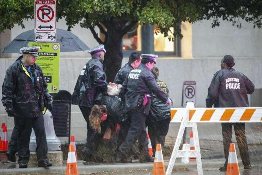 Houston police detain an unidentified woman near Minute Maid Park before Obama's arrival. (Karen Warren / Houston Chronicle)
