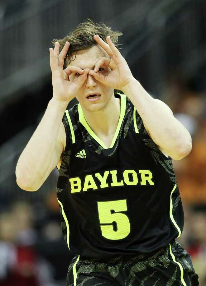 KANSAS CITY, MO - MARCH 09:  Brady Heslip #5 of the Baylor Bears celebrates a three pointer in the second half against the Kansas Jayhawks during the semifinals of the 2012 Big 12 Men's Basketball Tournament at Sprint Center on March 9, 2012 in Kansas City, Missouri. Photo: Jamie Squire, Getty Images / 2012 Getty Images