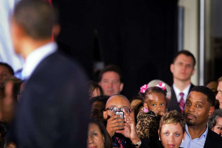 A supporter snaps a picture of the president in Houston. Photo: Smiley N. Pool, Houston Chronicle / © 2012  Houston Chronicle