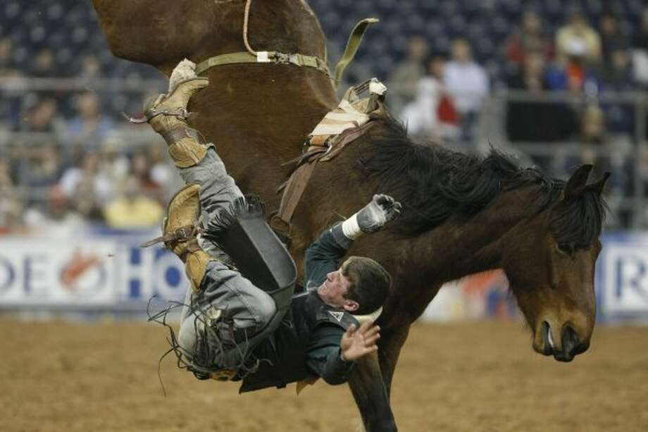 Tilden Hooper of Carthage, Tx, gets knocked off his horse as he competes in the Bareback Riding competition during Rodeo Houston Tuesday, March 4, 2008, in Reliant Stadium in Houston. (Nick de la Torre / Chronicle)