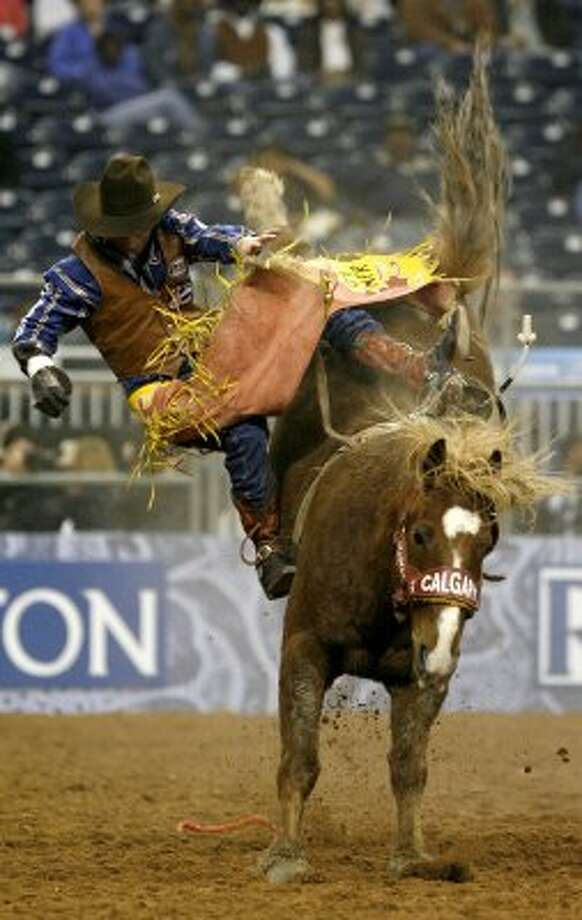 "Tilden Hooper gets tossed off of ""Loganberry"" during the Bareback Riding portion at the Houston Livestock Show and Rodeo, Friday, March 5, 2010, in Houston. (Karen Warren / Chronicle)"