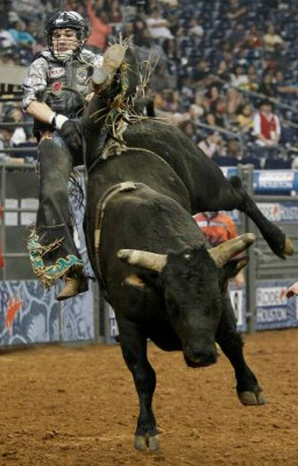 Cody Rostockyj competes in Bull Riding during the Rodeo Houston BP Super Series II at Reliant Stadium on Friday, March 2, 2012, in Houston. (Mayra Beltran / Chronicle)