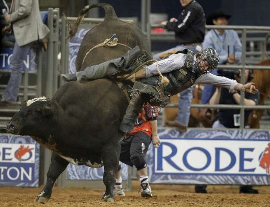Cody Rostockyj competes in Bull Riding during the BP Super Series II Round 2 at Reliant Stadium on Saturday, March 3, 2012, in Houston. (Mayra Beltran / Chronicle)
