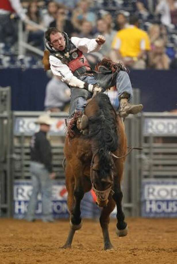 Bo Casper competes in Bareback Riding during the BP Super Series II Round 2 at Reliant Stadium on Saturday, March 3, 2012, in Houston. (Mayra Beltran / Chronicle)