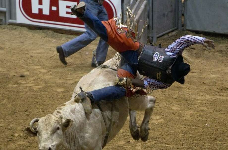 Tavarus Stubbs is thrown from a bull during the bull riding event of the rodeo at the Humble Civic Arena Saturday, Feb. 25, 2012, in Humble. (Chronicle)