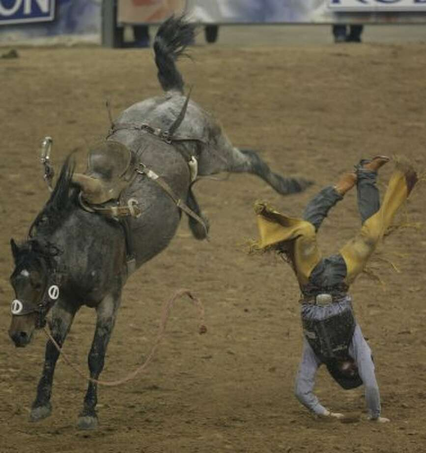 Sam MacKenzie, of Jordan Valley, Oregon, gets bucked off the horse during the Saddle Bronc Riding event at the Houston Rodeo on Friday, March 14, 2008, in Houston. (Julio Cortez / Chronicle)