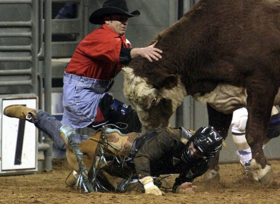 Brandon Reynolds of Pile Road, Alabama goes down during Rodeo Houston Wednesday, March 5, 2008, in Reliant Stadium in Houston.  (Julio Cortez / Chronicle)
