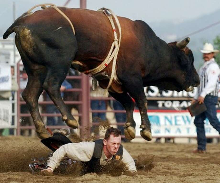 Rowdy Payton, from Farmington, N.M., hits the dirt during the bull riding competition Sunday, Oct. 5, 2003 at the San Dimas Western Days Rodeo in San Dimas, Calif. Payton was not injuried. (Will Lester / Inland Valley Daily Bulletin)