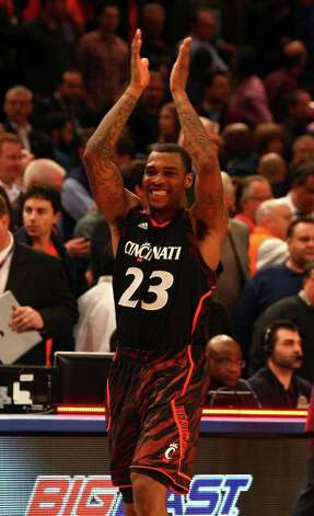 NEW YORK, NY - MARCH 09: Sean Kilpatrick #23 of the Cincinnati Bearcats celebrates after defeating the Syracuse Orange during the semifinals of the Big East men's basketball tournament at Madison Square Garden on March 9, 2012 in New York City.  (Photo by Mike Lawrie/Getty Images) Photo: Mike Lawrie, Getty Images / 2012 Getty Images