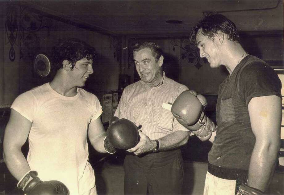 Jimmy Parks Jr. (from left), Jimmy Parks Sr., and heavyweight Terry Krueger trained at the old Alamo Boxing Gym. Photo: Courtesy Photo
