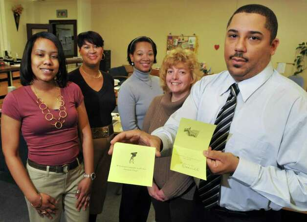 Albany City Clerk staff members, from left, Kiyunda Nobles, Regina Goodbee, Alexis Gomes-Evans, Melinda Griffith and City Clerk Nala Woodard with pet condolences cards in their Albany City Hall offices Wednesday March 7, 2012.    (John Carl D'Annibale / Times Union) Photo: John Carl D'Annibale