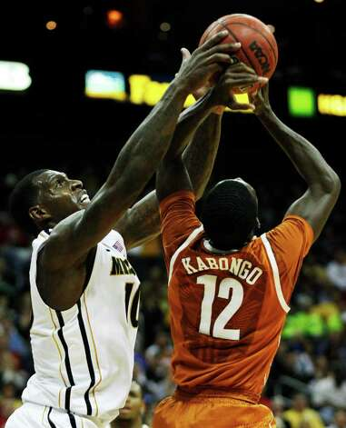 Missouri forward Ricardo Ratliffe (10) battles for a rebound with Texas guard Myck Kabongo (12) during the first half of an NCAA college basketball game in the Big 12 Conference tournament Friday, March 9, 2012, in Kansas City, Mo. Photo: AP