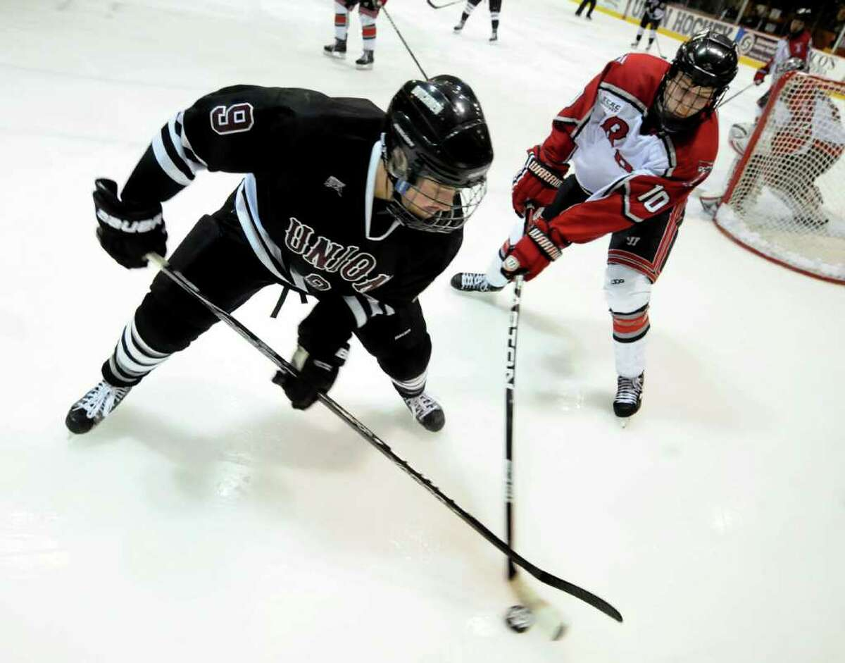 Union's Daniel Carr (9), left, and RPI's Curtis Leonard (10) battle for the puck during the first ECAC quarterfinal hockey game on Friday, March 9, 2012, at Union College in Schenectady, N.Y. (Cindy Schultz / Times Union)