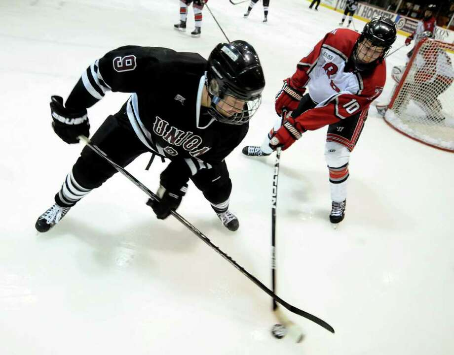 Union's Daniel Carr (9), left, and RPI's Curtis Leonard (10) battle for the puck during the first ECAC quarterfinal hockey game on Friday, March 9, 2012, at Union College in Schenectady, N.Y. (Cindy Schultz / Times Union) Photo: Cindy Schultz / 00016700A