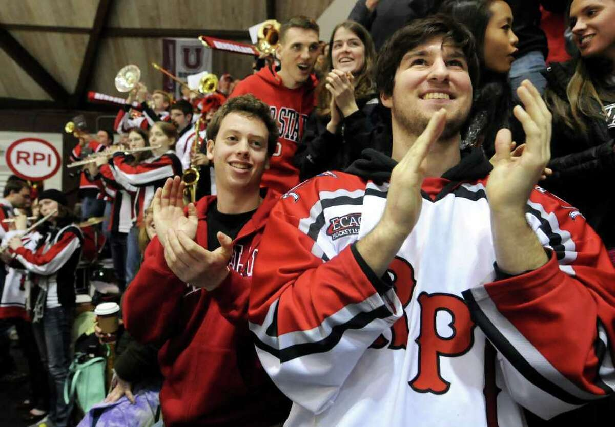RPI students Dana Schnabel, 21, center, and Michael Pawlak, 21, right, cheer when their team scores in the first ECAC quarterfinal hockey game against Union on Friday, March 9, 2012, at Union College in Schenectady, N.Y. (Cindy Schultz / Times Union)