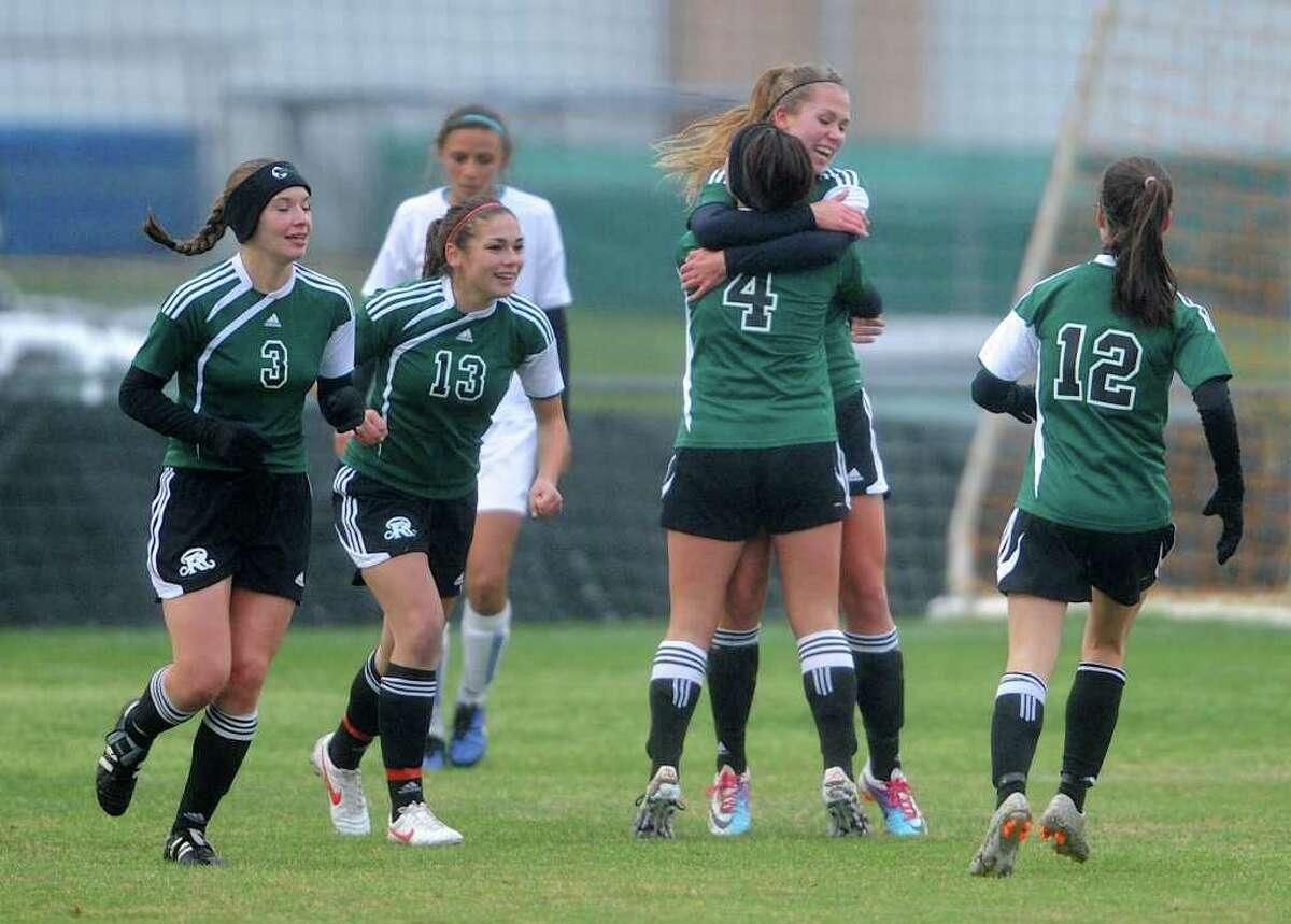 Reagan's Monica Penfield (10) is hugged by her teammate Gaby Loi (4) after Penfield scored during a 26-5A Girls Varsity Soccer Match between the Reagan Rattlers and the MacArthur Brahmas at the Blossom Soccer Stadium East Field In San Antonio, Texas on March 9, 2012. John Albright / Special to the Express-News.