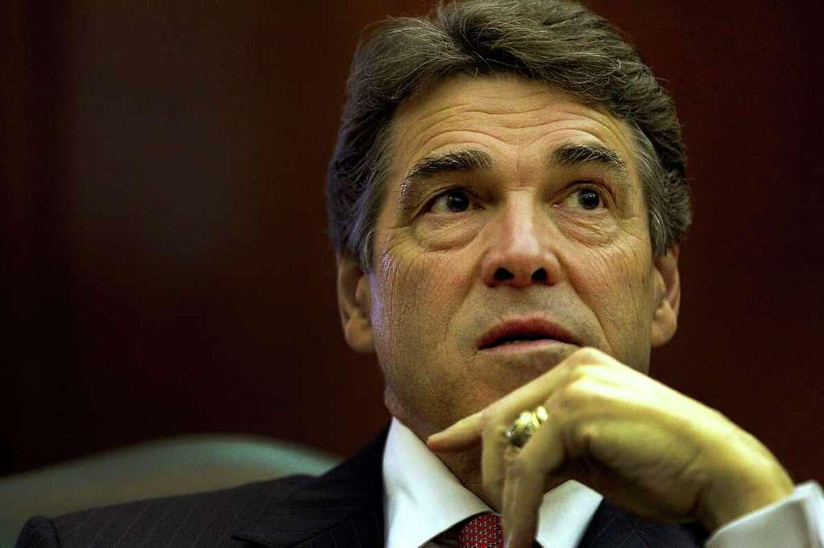 Rick Perry had back surgery last year. AP Photo/Austin American-Statesman, Ralph Barrera)
