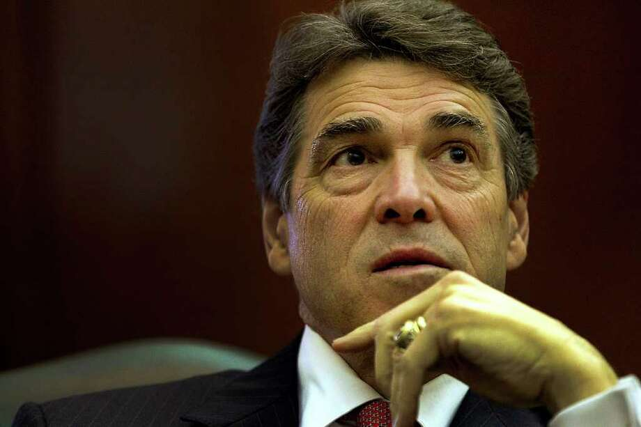 Rick Perry had back surgery last year. AP Photo/Austin American-Statesman, Ralph Barrera) Photo: Ralph Barrera, Associated Press / Austin American-Statesman