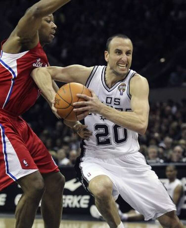 Manu Ginobili clears his way into the lane against Bobby Simmons as the Spurs host the Los Angeles Clippers at the AT&T Center  on March 9, 2012 Tom Reel/ San Antonio Express-News (TOM REEL / San Antonio Express-News)