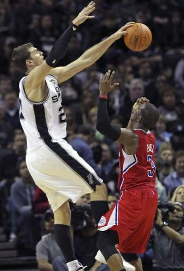 Tiago Splitter makes a block on Chris Paul in the second half as the Spurs host the Los Angeles Clippers at the AT&T Center  on March 9, 2012 Tom Reel/ San Antonio Express-News (TOM REEL / San Antonio Express-News)