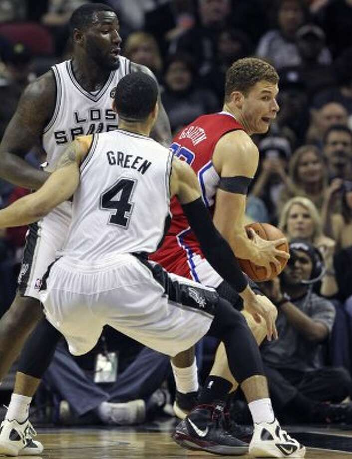 Blake Griffin turns on DeJuan Blair and Danny Green  as the Spurs host the Los Angeles Clippers at the AT&T Center  on March 9, 2012 Tom Reel/ San Antonio Express-News (TOM REEL / San Antonio Express-News)