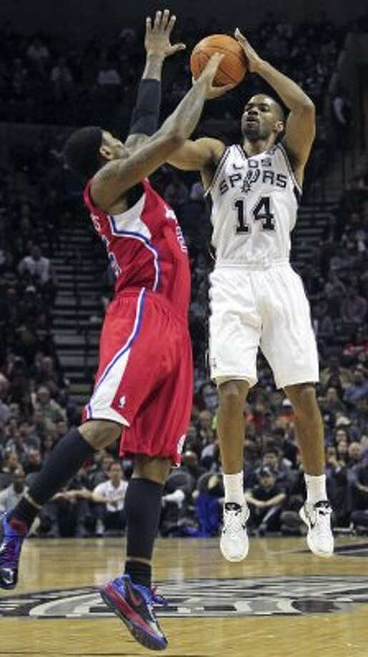 Gary Neal shoots over Mo Williams as the Spurs host the Los Angeles Clippers at the AT&T Center  on March 9, 2012 Tom Reel/ San Antonio Express-News (TOM REEL / San Antonio Express-News)