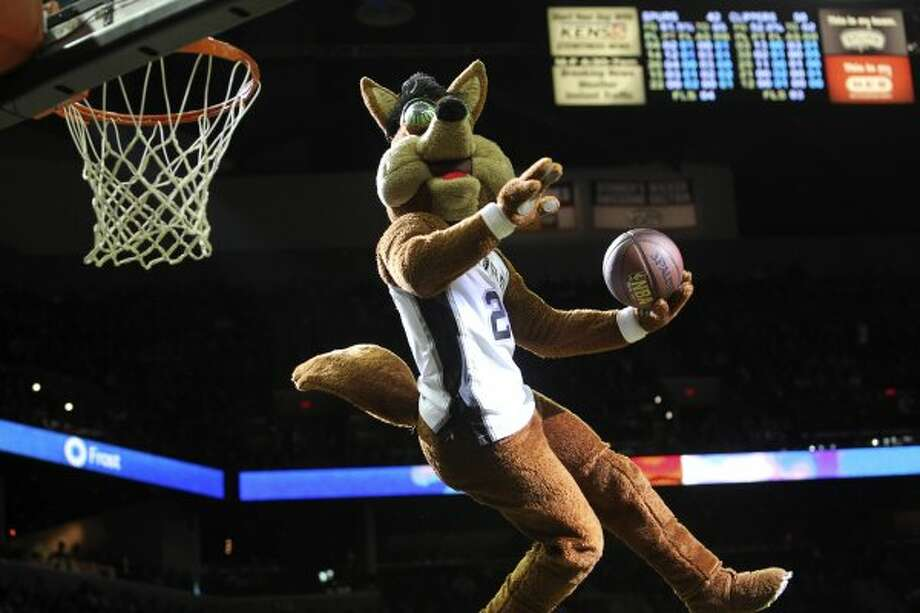The Coyote soars for a slam dunk as the Spurs host the Los Angeles Clippers at the AT&T Center  on March 9, 2012 Tom Reel/ San Antonio Express-News (TOM REEL / San Antonio Express-News)