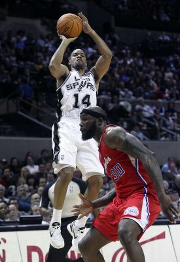 Gary Neal pulls up for a jumper in the first half as the Spurs host the Los Angeles Clippers at the AT&T Center  on March 9, 2012 Tom Reel/ San Antonio Express-News (TOM REEL / San Antonio Express-News)