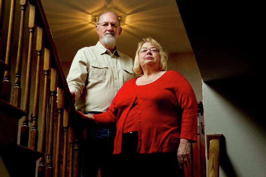 In this March 6, 2012 photo, Cheryl Friedman and her husband, Jim, pose for a portrait at their home in St. Louis. After taking a hit to their savings in 2008 and 2009, the retired couple pulled most of their money from stocks after the meltdown and have not put it back into the market since then. (AP Photo/Whitney Curtis) Photo: Whitney Curtis / FR91291 AP