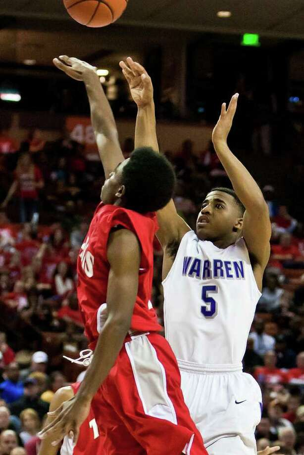 Warren's Marcus Keene gets off a jump shot over Fort Bend Travis's John Burnett during the third quarter of their 5A state semifinal game at the Frank Erwin Center in Austin on March 9, 2012.  MARVIN PFEIFFER/ mpfeiffer@express-news.net Photo: MARVIN PFEIFFER, Express-News / Express-News 2012