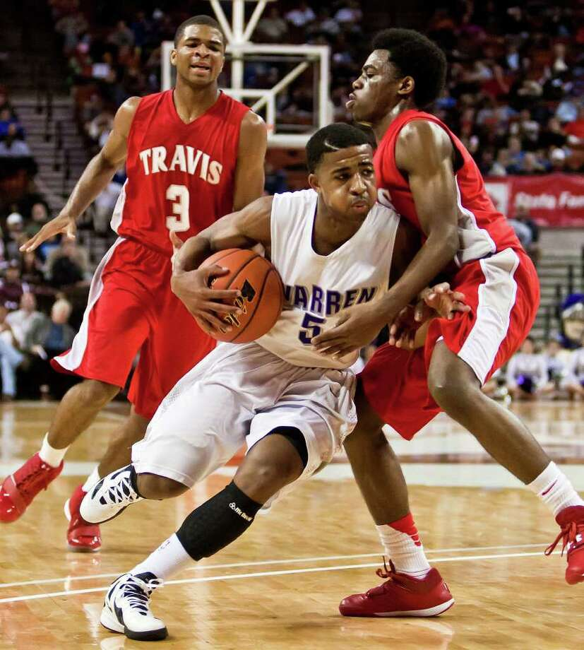 Warren's Marcus Keene (center) tries to drive around Fort Bend Travis's John Burnett as Aaron Harrison looks on during the second quarter of their 5A state semifinal game at the Frank Erwin Center in Austin on March 9, 2012. Fort Bend Travis won the game 85-72.  MARVIN PFEIFFER/ mpfeiffer@express-news.net Photo: MARVIN PFEIFFER, Express-News / Express-News 2012