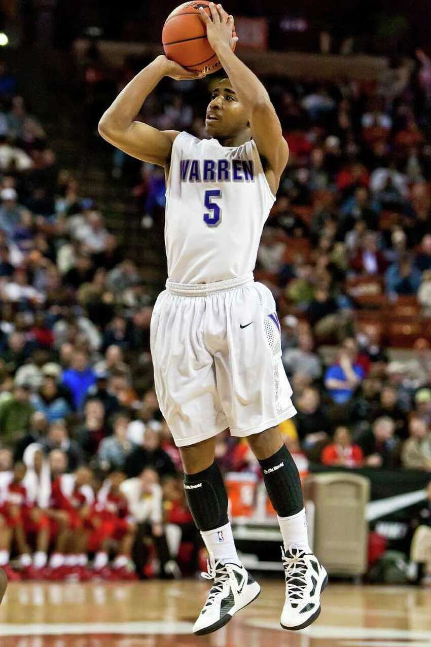 Warren's Marcus Keene pulls up for a fourth quarter three-pointer during their 5A state semifinal game with Fort Bend Travis at the Frank Erwin Center in Austin on March 9, 2012. MARVIN PFEIFFER/ mpfeiffer@express-news.net