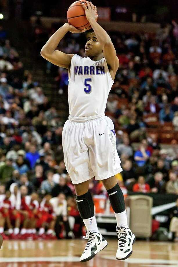 Warren's Marcus Keene pulls up for a fourth quarter three-pointer during their 5A state semifinal game with Fort Bend Travis at the Frank Erwin Center in Austin on March 9, 2012. MARVIN PFEIFFER/ mpfeiffer@express-news.net Photo: MARVIN PFEIFFER, Express-News / Express-News 2012