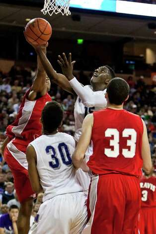 Warren's Taurean Waller-Prince tries to put up a layup during their 5A state semifinal game with Fort Bend Travis at the Frank Erwin Center in Austin on March 9, 2012.  MARVIN PFEIFFER/ mpfeiffer@express-news.net Photo: MARVIN PFEIFFER, Express-News / Express-News 2012
