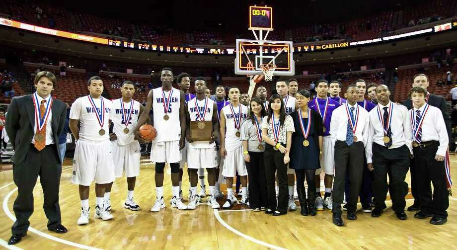 The Warren basketball team poses for a team photo following their 5A state semifinal game with Fort Bend Travis at the Frank Erwin Center in Austin on March 9, 2012.  MARVIN PFEIFFER/ mpfeiffer@express-news.net Photo: MARVIN PFEIFFER, Express-News / Express-News 2012