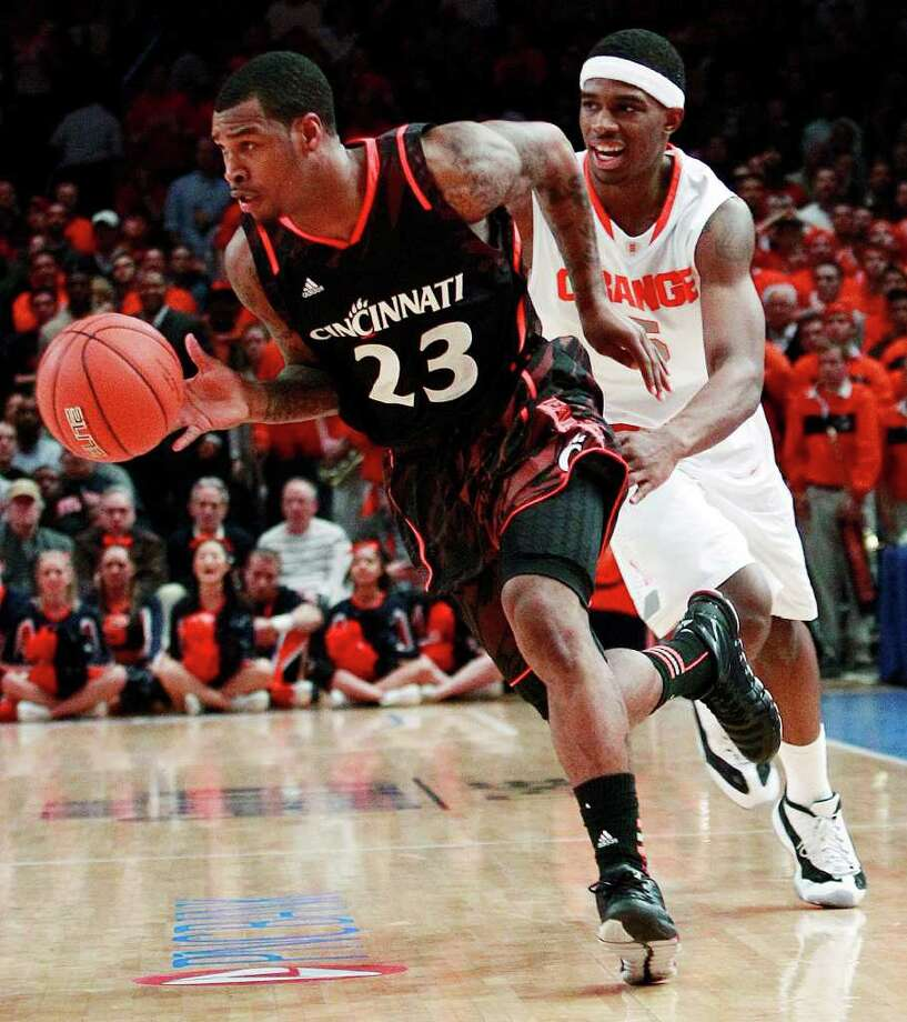 Cincinnati's Sean Kilpatrick (23) drives past Syracuse's C.J. Fair (5) during the second half of an NCAA college basketball game in the semifinals of the Big East Conference tournament in New York, Friday, March 9, 2012. Cincinnati won the game 71-68. Photo: Frank Franklin II