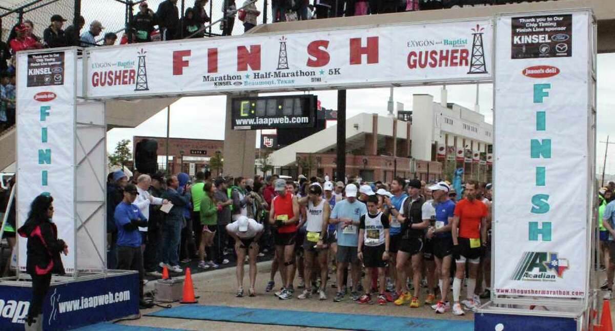 Runners participate in the Gusher Marathon, Half Marathon and 5K race in Beaumont on Saturday. Kevin Daigle/The Enterprise